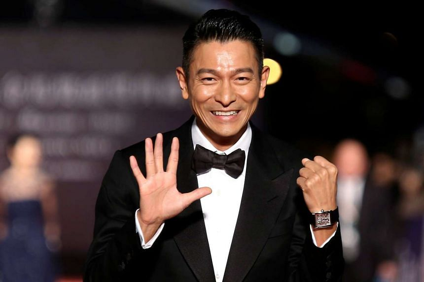 Hong Kong actor Andy Lau posing for photographers on the red carpet at the 50th Golden Horse Film Awards in Taipei, on Nov 23, 2013.