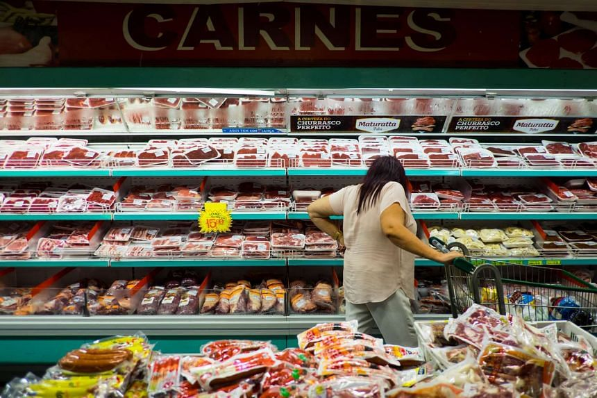 A customer shops for meat in a supermarket in Sao Paulo, Brazil, on Friday, March 17, 2017.
