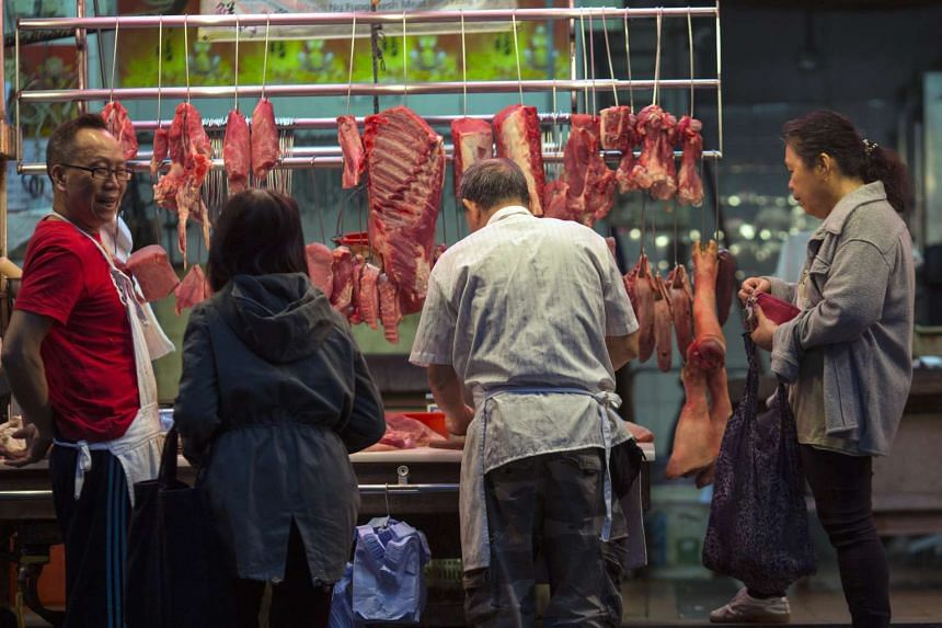 Patrons buy meat from a butcher stall in Hong Kong, China, March 22, 2017.