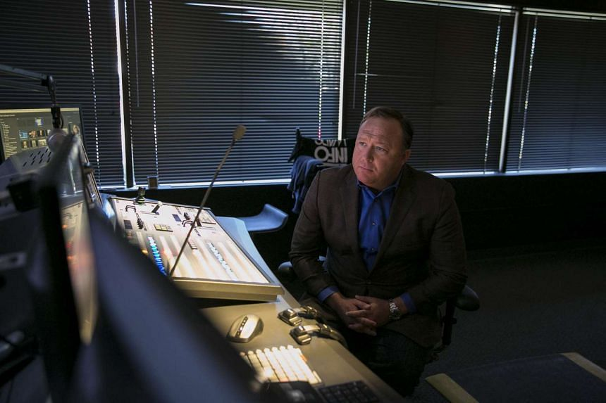 Prominent conspiracy theorist Alex Jones in the control room for his right-wing radio show, in Austin, Texas, on Feb 17, 2017.
