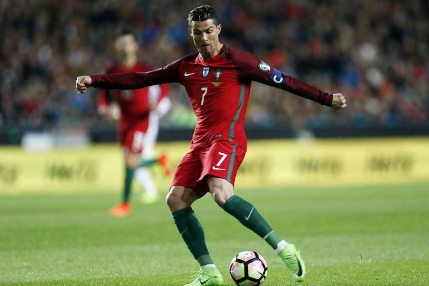 Portugal's Cristiano Ronaldo scores a goal during the 2018 FIFA World Cup Russia group B qualifying soccer match against Hungary.