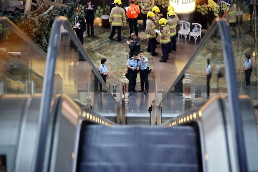 An escalator malfunctioned at Langham Place shopping mall in Mong Kok on Saturday, injuring at least 18 people after the upward-running escalator lost momentum and then began to run in reverse at high speed.