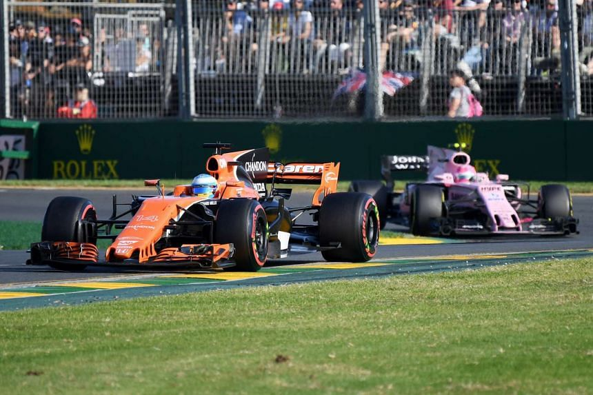 Spanish driver Fernando Alonso of McLaren Honda drives ahead of Mexican driver Sergio Perez of Sahara Force India during the 2017 Formula One Australian Grand Prix at Albert Park GP Circuit in Melbourne, Australia, March 26, 2017.