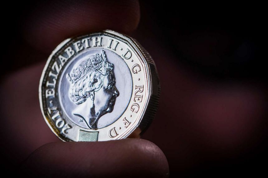 Britain's Royal Mint is making 1.5 billion new one pound coins, which will enter circulation on Tuesday, with security features such as a unique 12-sided, bimetallic design, a hologram, fine lettering and some secret tricks to beat crooks.