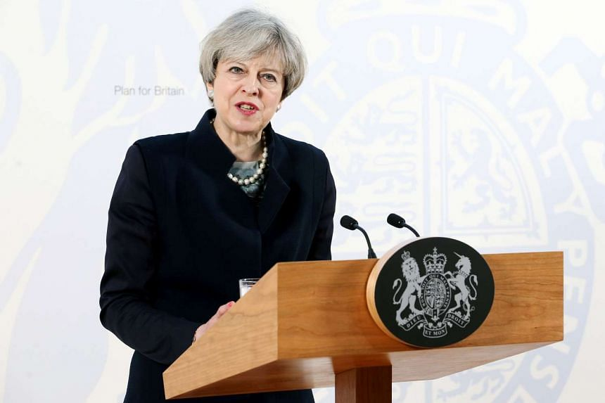 Britain's Prime Minister Theresa May delivers a speech at the Department for International Development's office at Abercrombie House in East Kilbride, south-west Scotland, on March 27, 2017.
