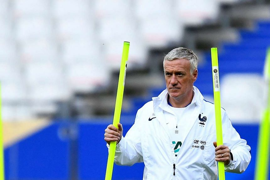 France's head coach Didier Deschamps attends in a training session at the Stade de France in Saint-Denis, north of Paris, on the eve of the of their friendly football match against Spain.