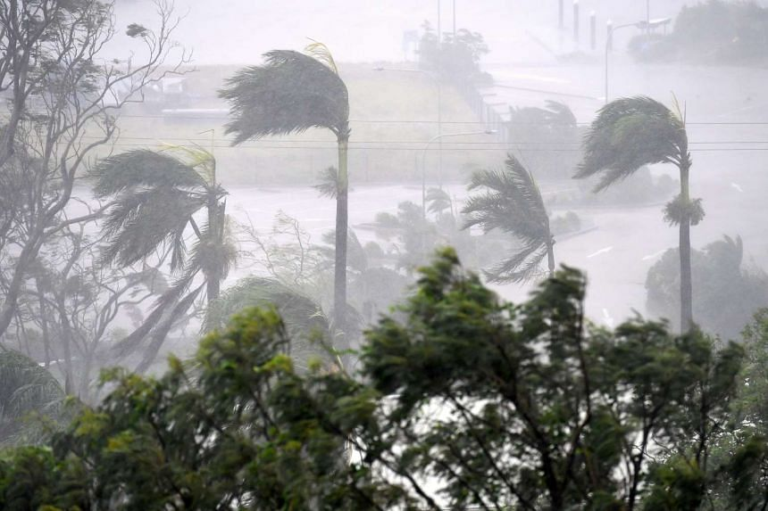 Strong wind and rain from Cyclone Debbie at Airlie Beach, located south of the northern Australian city of Townsville on Tuesday (March 28).