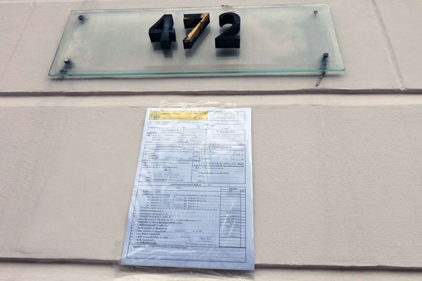 A tax form demanding overdue tax payments is posted at the gate of coup-ousted and exiled former Thai Prime Minister Thaksin Shinawatra's ex-wife's house in Bangkok, Thailand on March 28 2017.