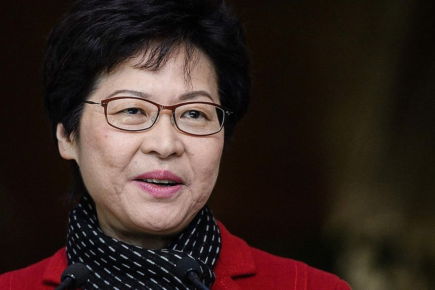 Just a day after Hong Kong's newly elected Chief Executive Carrie Lam (above) vowed to heal political divisions, nine pro-democracy activists were told by police yesterday they will be charged for their roles in the Occupy protests two years ago.