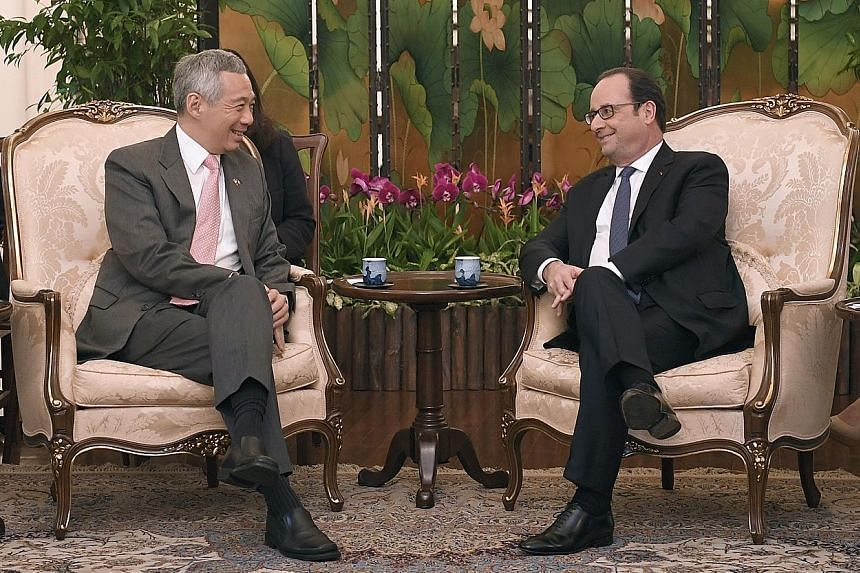 Mr Hollande calling on PM Lee at the Istana yesterday, the second and final day of his state visit here. The French President said leaders must show that the only solution for a fairer world is multilateralism, compliance with international law, resp
