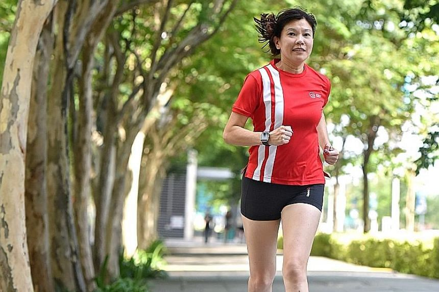 Ms Wong leads her team on 5km runs around Gardens by the Bay once a week after work. She also runs with her elder daughter on weekends and clocks about 20,000 steps every day by climbing the stairs.