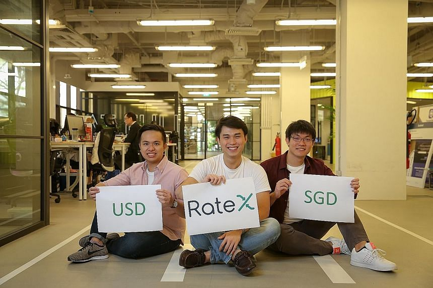 """From left: Mr Lim Jing Rong, Mr Goh and Mr Gay founded RateX, which aims to """"flatten"""" cross-border online shopping by offering real exchange rates. TravelersBox has kiosks at Changi Airport which let travellers convert their leftover foreign currency"""