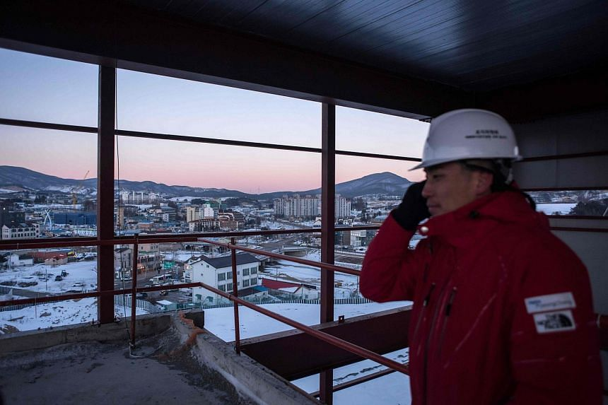 A worker at the construction site for the opening ceremony of the 2018 Pyeongchang Winter Olympic Games in the town of Hoenggye in Pyeongchang, South Korea.