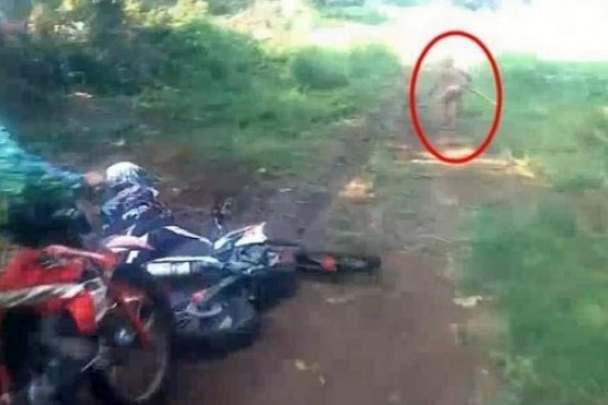 The mysterious figure, carrying a wooden stick, was spotted by some bikers at an Indonesian forest.