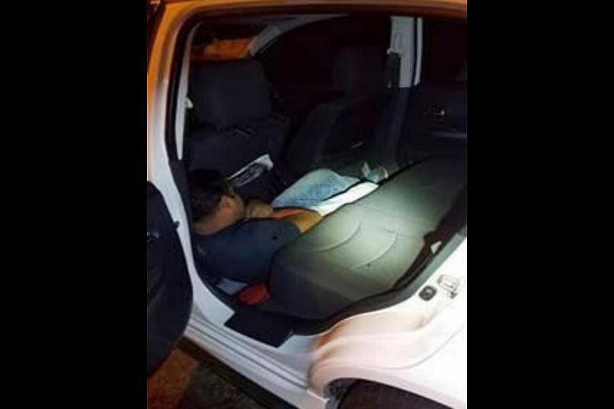 Bangladeshi overstayer Md Islam was found crouching on the floor of a Malaysia-registered car's rear passenger seat at Woodlands Checkpoint on Feb 14, 2016.