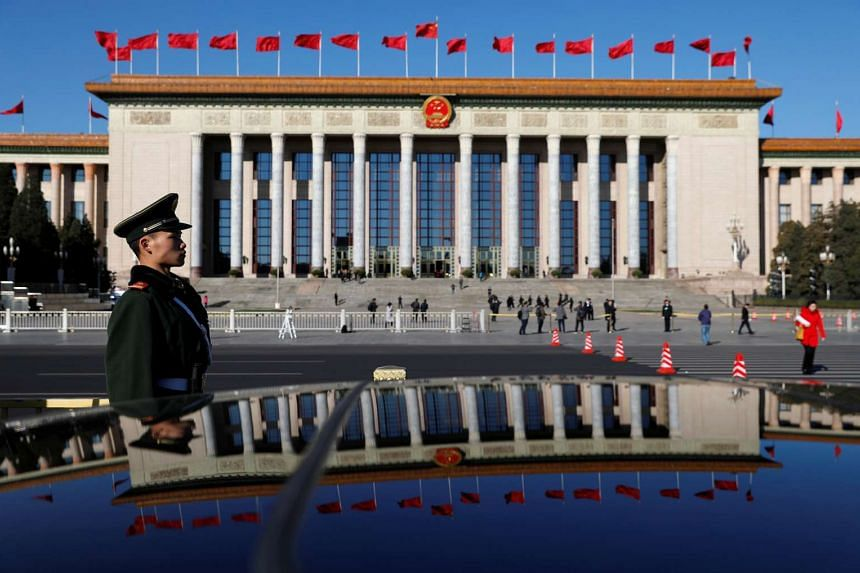 A paramilitary policeman standing guard in front of the Great Hall of the People at the Tiananmen Square, on March 12, 2017.