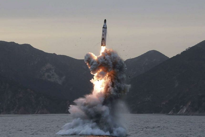 An undated file photo released on March 22, 2017, by the North Korean Central News Agency showing a test-fire of a strategic submarine ballistic missile.