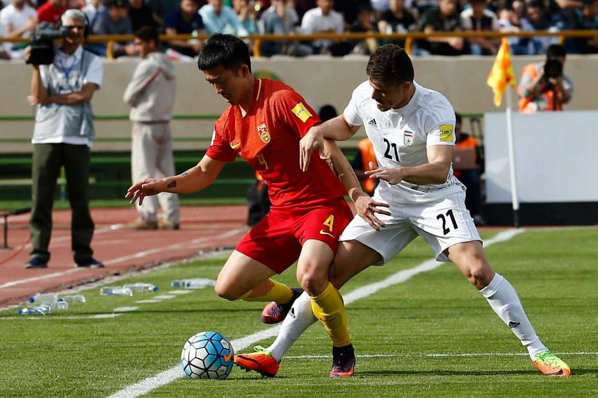 Iran's Vorya Ghafuri in action against China's Jiang Zhipeng (left) during the Fifa World Cup 2018 qualification match on March 28, 2017.