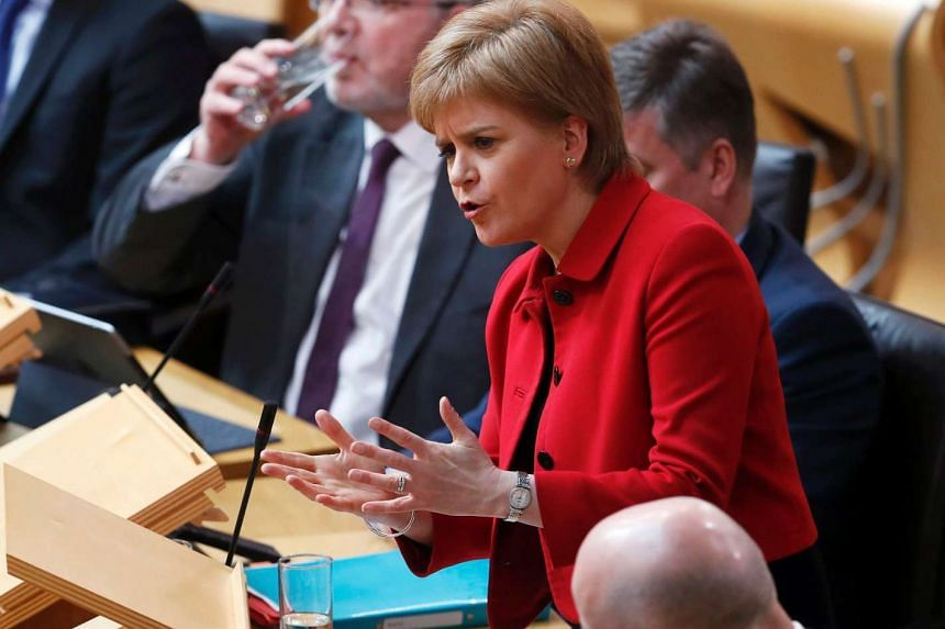 Scotland's First Minister Nicola Sturgeon speaks in the chamber on the second day of the 'Scotland's Choice' debate on a motion to seek the authority to hold an indpendence referendum, at the Scottish Parliament in Edinburgh, on March 28, 2017.