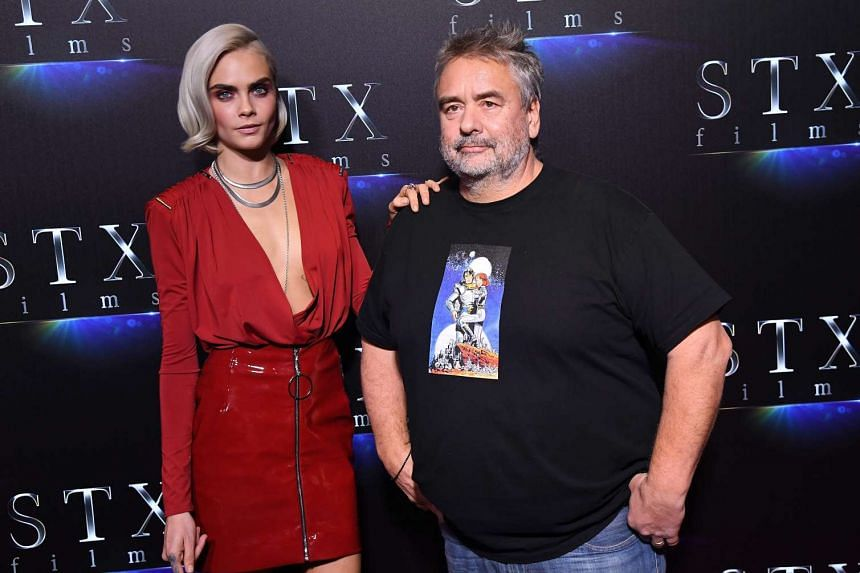 "Valerian's Cara Delevingne (left) and director Luc Besson attend STXfilms' ""The State of the Industry: Past, Present & Future"" presentation during CinemaCon at Caesars Palace."