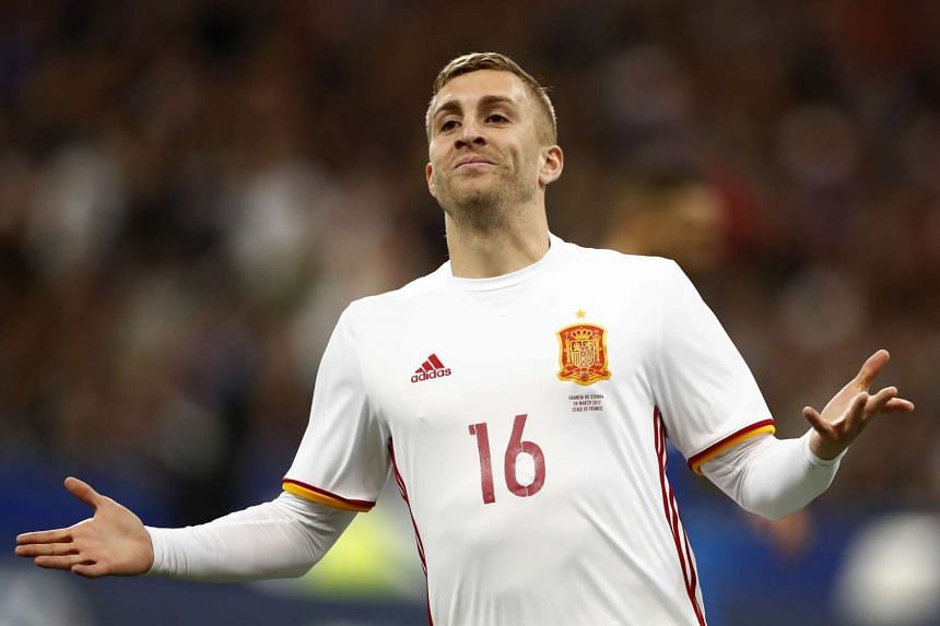 Spain's Gerard Deulofeu celebrates scoring their second goal during their international friendly match against France on March 28, 2017.