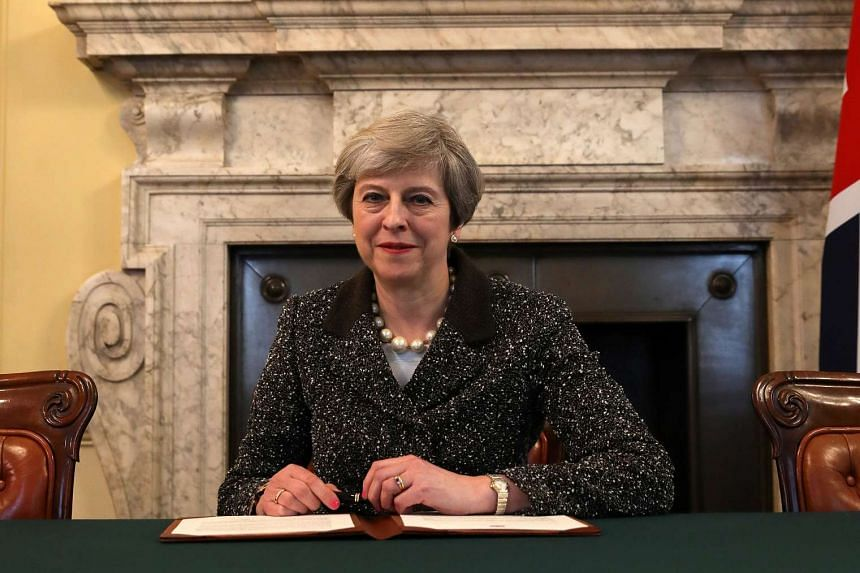 British Prime Minister Theresa May in the cabinet office to sign the official letter to European Council President Donald Tusk invoking Article 50 and the United Kingdom's intention to leave the EU, on March 28, 2017.