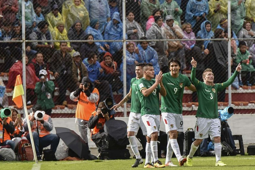 Bolivia's forward Juan Arce (left) celebrates with teammates after scoring against Argentina during their 2018 Fifa World Cup qualifier football match.