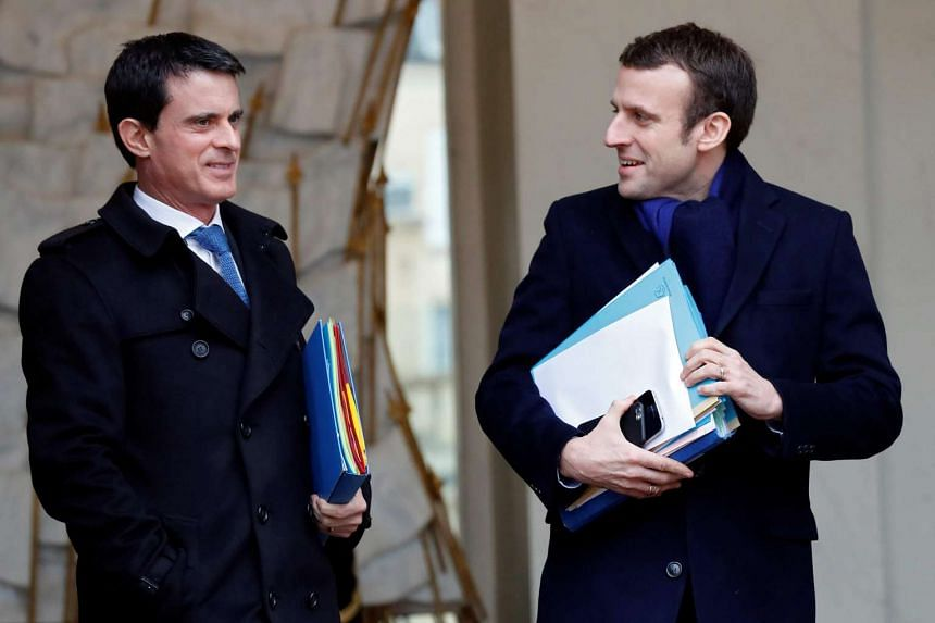 French Prime Minister Manuel Valls (Left) and Economy Minister Emmanuel Macron (Right) leave the Elysee palace in Paris, France, following the weekly cabinet meeting on March 9, 2016.