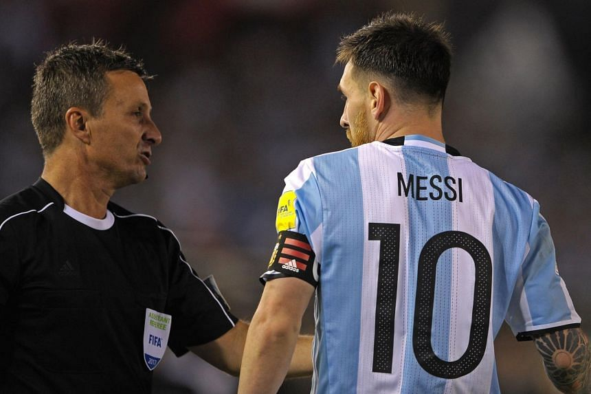 Argentina's forward Lionel Messi (right) argues with Brazilian first assistant referee Emerson Augusto de Carvalho the 2018 Fifa World Cup qualifier match against Chile on March 23, 2017.