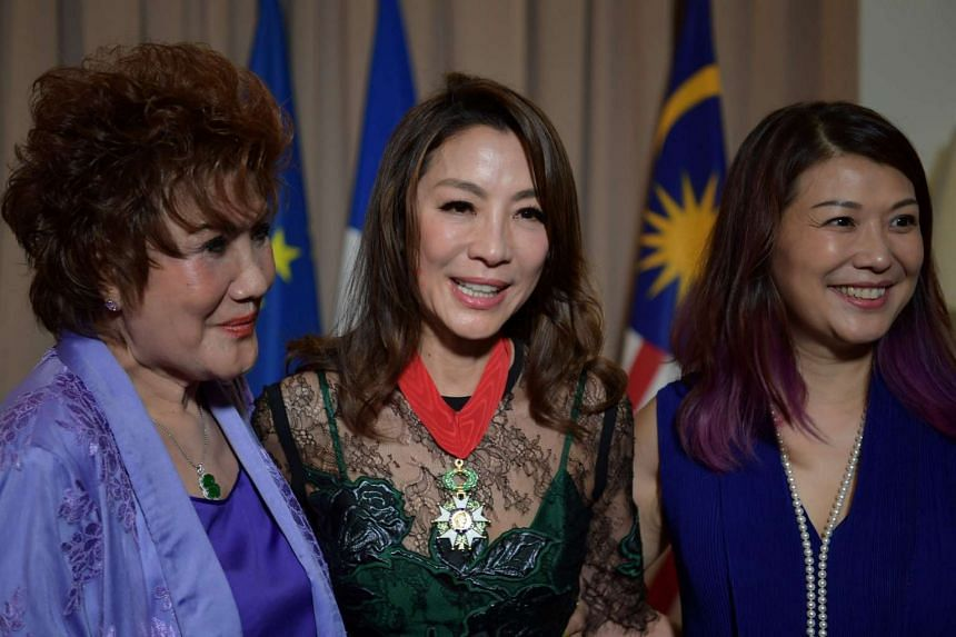 Yeoh with her mother (left) after being awarded the Legion d'Honneur by French President Francois Hollande.
