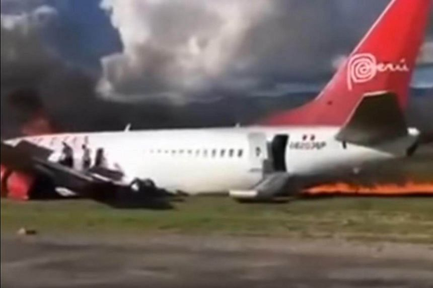 Boeing 737-300 jet which caught fire on Tuesday (March 28) while landing at an airport near the Andean town of Jauja in central Peru.