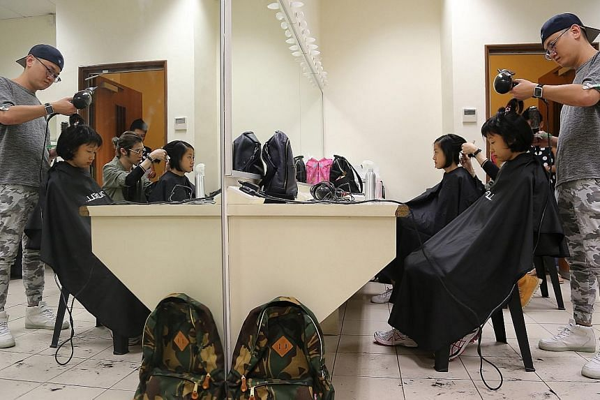 Some Nanyang Girls' High School student-actors had their hair cut to portray 1930s and 1980s students in a 45-minute movie, produced as part of the Nanyang family of schools' centenary celebrations this year. The festivities also include a gala dinne