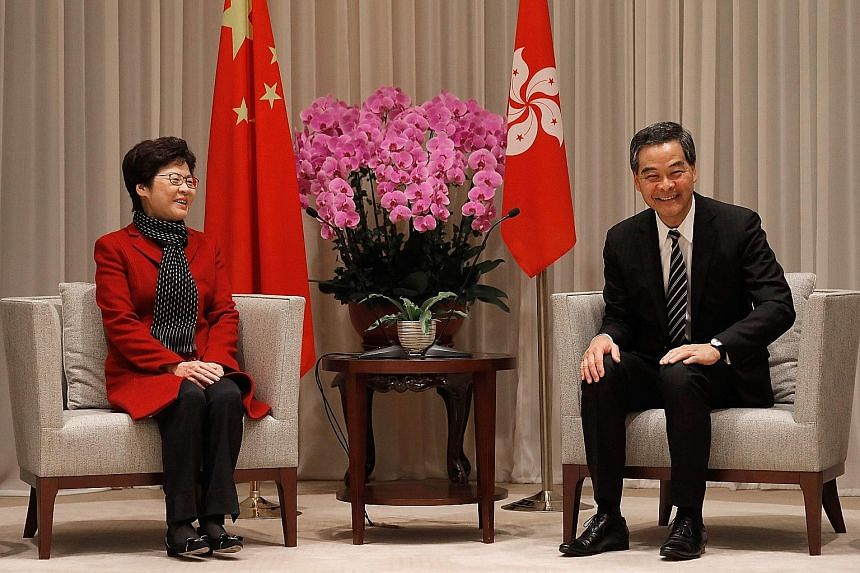 Mrs Carrie Lam and Mr Leung Chun Ying at a press conference on Monday, a day after the former won the election. But some feel there is a power struggle between the two.