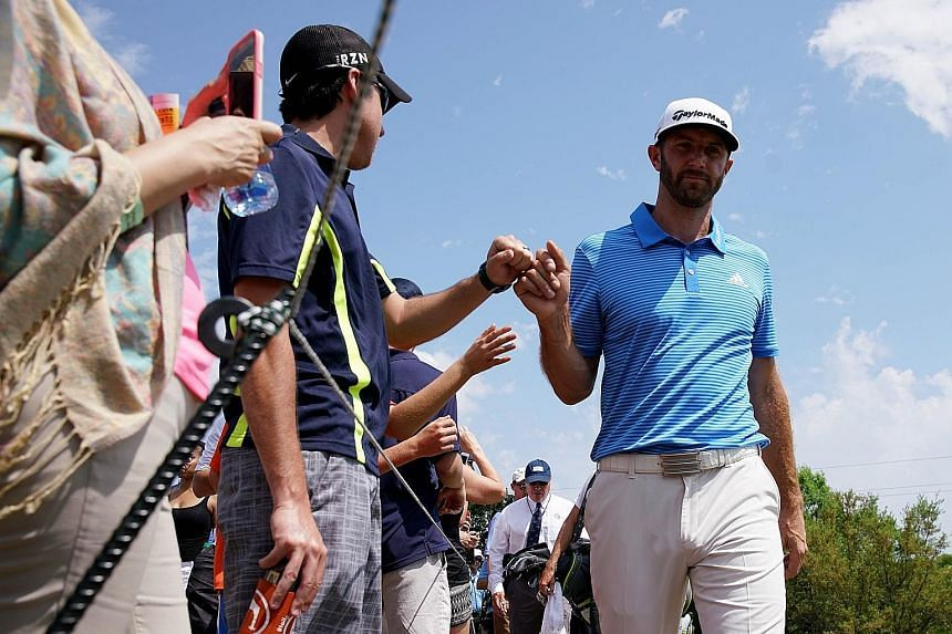 Dustin Johnson gives a fan a fist bump at the WGC-Match Play. The in-form world No. 1 is tipped to be a handful at the Masters.