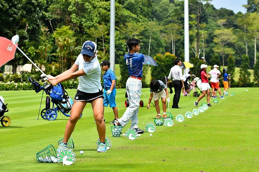 Promising golfers teeing off at the driving range at Sentosa Golf Club. About 70 locals took part in the inaugural Singapore Golf Association's (SGA) Junior Invitational. The nine-hole tournament at the Serapong Course featured four divisions (Under-