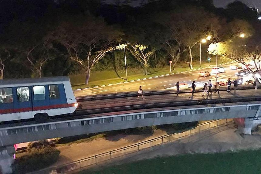 Commuters experienced an unexpected stop at around 8.30pm yesterday when part of the Bukit Panjang Light Rail Transit service was suspended for about an hour due to a train fault. Passengers were seen clambering out of a marooned train onto the track