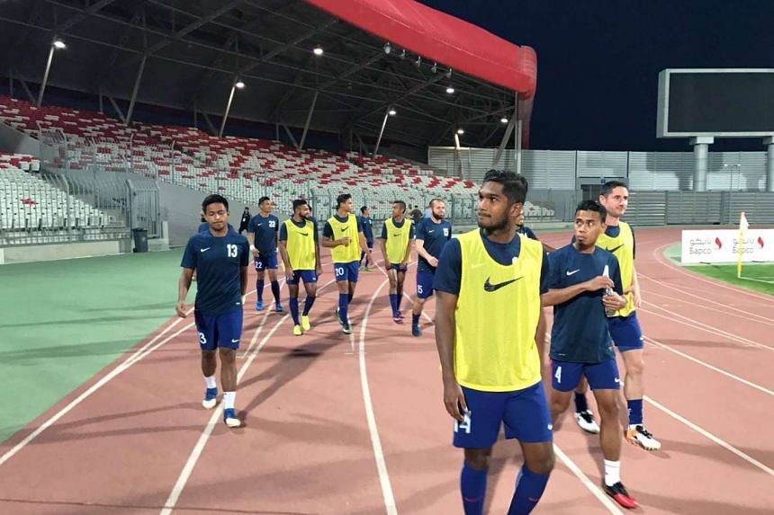 Singapore and Bahrain played to a goalless away draw in their Asian Football Confederation Asian Cup qualifiers third round opening group match.