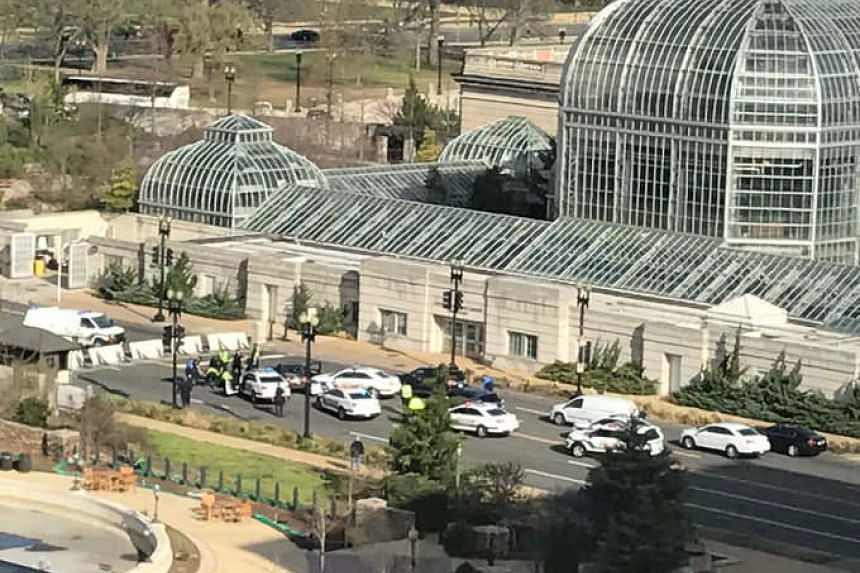 US police cars are seen around the US Capitol after a driver reportedly tried to run over police officers nearby.
