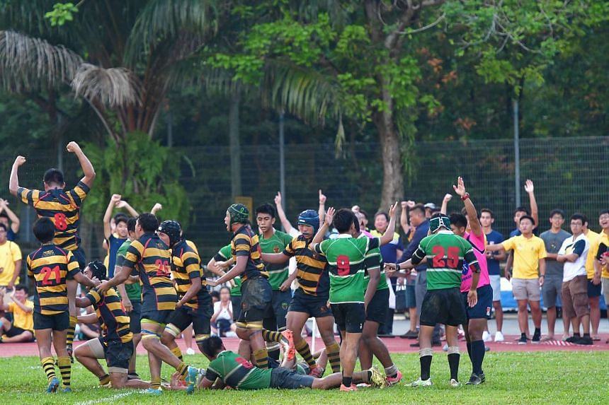 ACS (I) players celebrating after they defeated RI in the B Division rugby title match, on March 29, 2017.