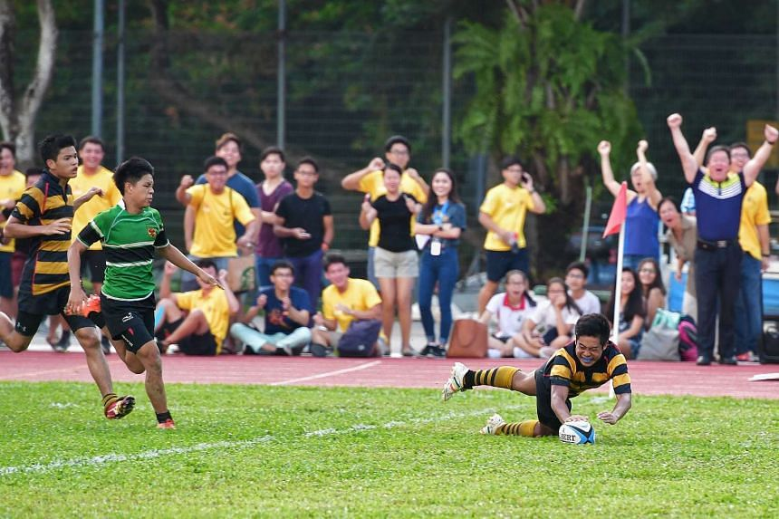 ACS (I)'s Finan Siow scoring a try during the B Division rugby title match on March 29, 2017.