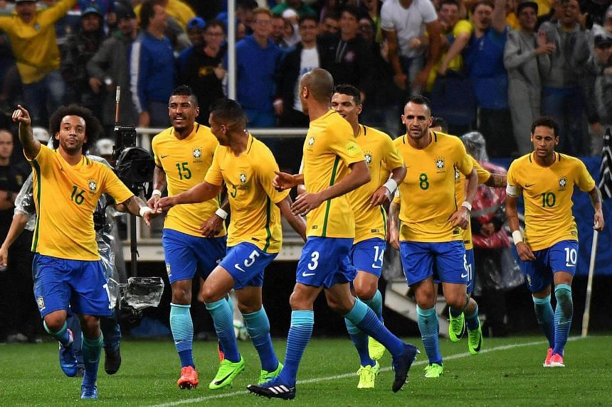 Brazil's midfielder Marcelo (left) celebrating with teammates after scoring against Paraguay during their 2018 Fifa World Cup qualifier football match in Sao Paulo, Brazil on March 28, 2017.