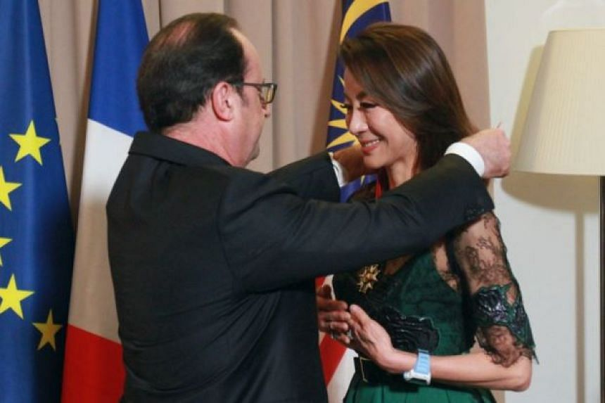Michelle Yeoh (right) was conferred the title, the highest honour available to a non-French citizen, by French President François Hollande.
