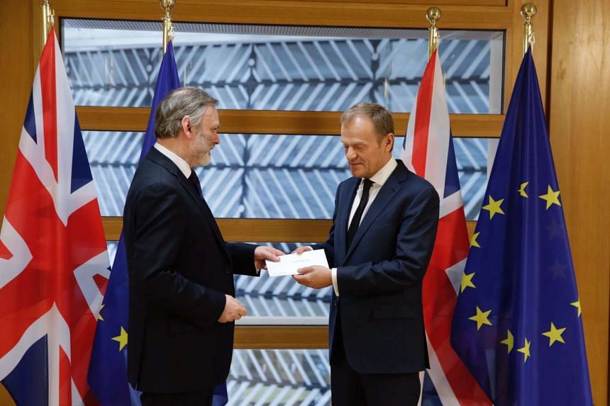 European Council president Donald Tusk (right) receiving the Brexit notification letter from British envoy Tim Barrow on March 29, 2017.