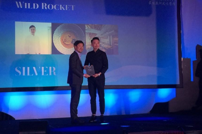 Chef-owner Willin Low of Wild Rocket at Mount Emily receives a Silver award at the Best Asian Restaurants Awards on March 29, 2017.
