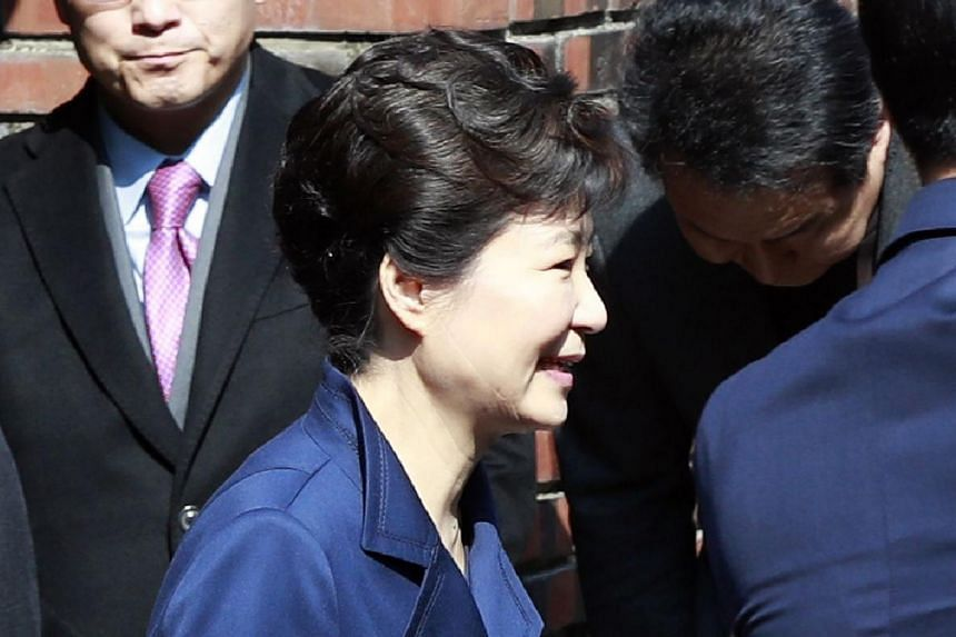 South Korea's former President Park Geun Hye leaves her home for a hearing at the Seoul Central District Court to fight against the prosecution's request for an arrest warrant against her on corruption charges.