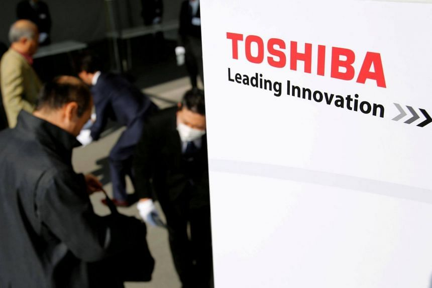 Shareholders arrive at Toshiba's extraordinary shareholders meeting in Chiba, Japan, on March 30, 2017.