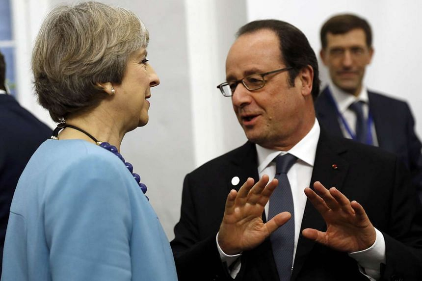 British Prime Minister Theresa May and French President Francois Hollande at the European Union leaders summit in Malta on Feb 3, 2017.