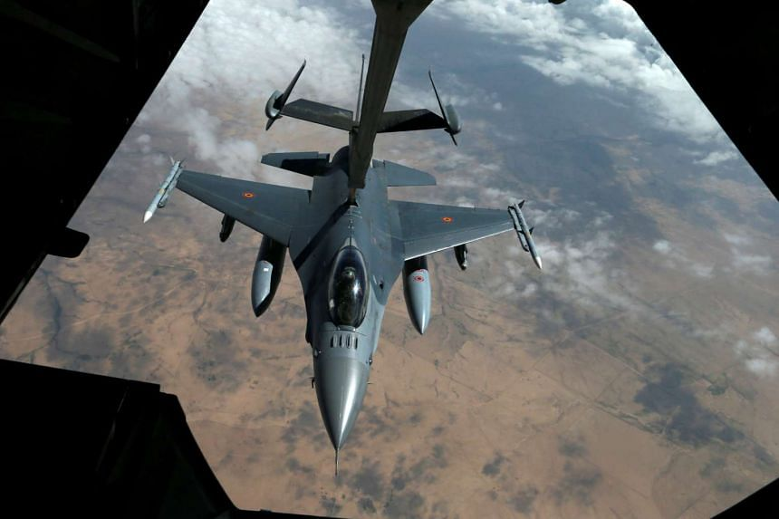 A US Air Force F-16 refuels in the sky.
