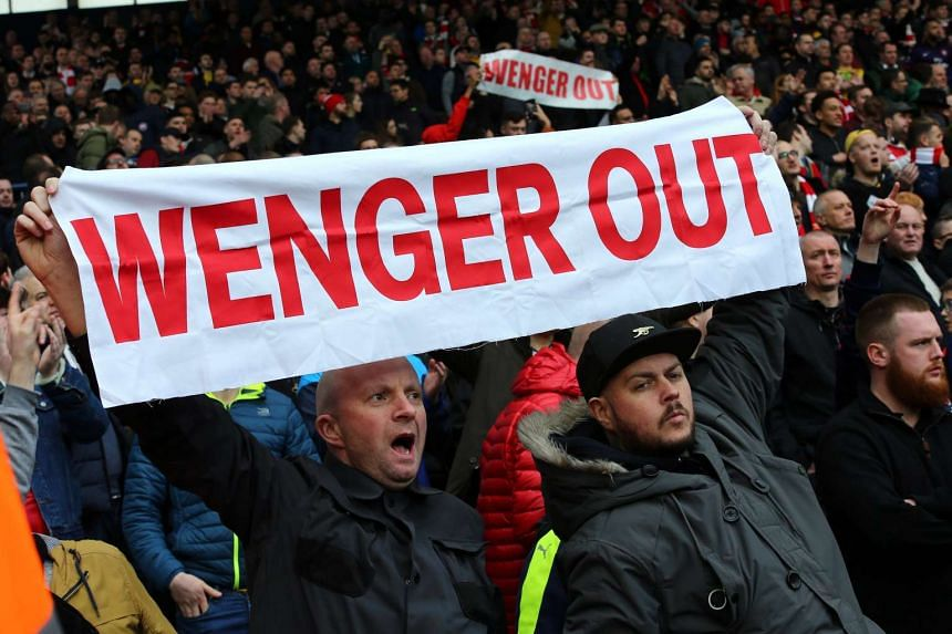 Fans protesting over Arsenal's manager, Arsene Wenger, during a match against West Bromwich Albion on March 18, 2017.