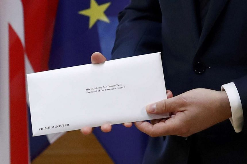 British Prime Minister Theresa May's Brexit letter is delivered into the hands of EU Council president Donald Tusk.